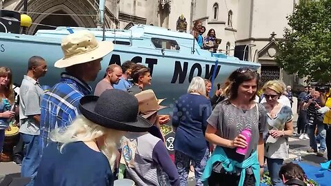 Extinction Rebellion boat blocks road outside Royal Courts of Justice in London