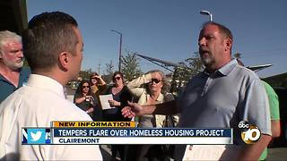 Tempers flare over homeless housing project - Video