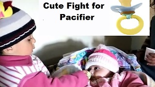 Two babies fight over pacifier  - Video