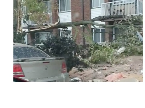 Road Covered in Debris After Tornado Rips Through Gatineau, Quebec