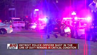 Detroit police officer shot in the line of duty remains in critical condition - Video