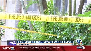 13 people forced from home due to fire - Video
