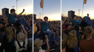 Amazing moment when crowd at a festival lifts up a man in a wheelchair - Video