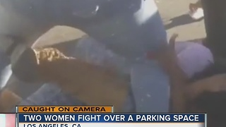 Two women battle it out for parking space - Video