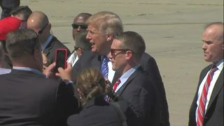 President Trump greets on-lookers at KCI - Video