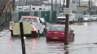 Tow Truck Pushes Vehicle Out of Long Island Floodwater - Video