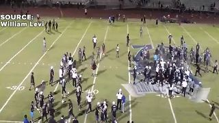 Police pepper spray crowd during fight after high school football game - Video