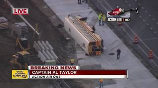 School bus overturns following crash, 6 injured - Video
