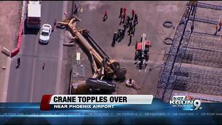 Person unaccounted for after crane falls near Phoenix Sky Harbor Airport - Video