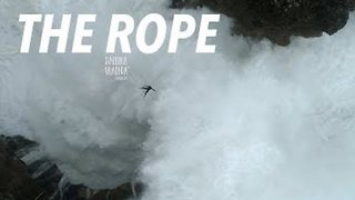 Fearless Man Walks the Line Over Mammoth Waves in Portugal - Video