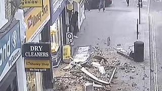 CCTV captures roof collapse on busy London street - Video