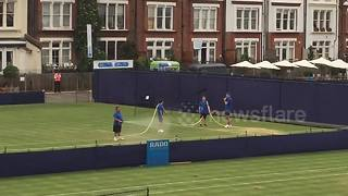 How many men does it take to water a tennis court at the Queen's Club? - Video