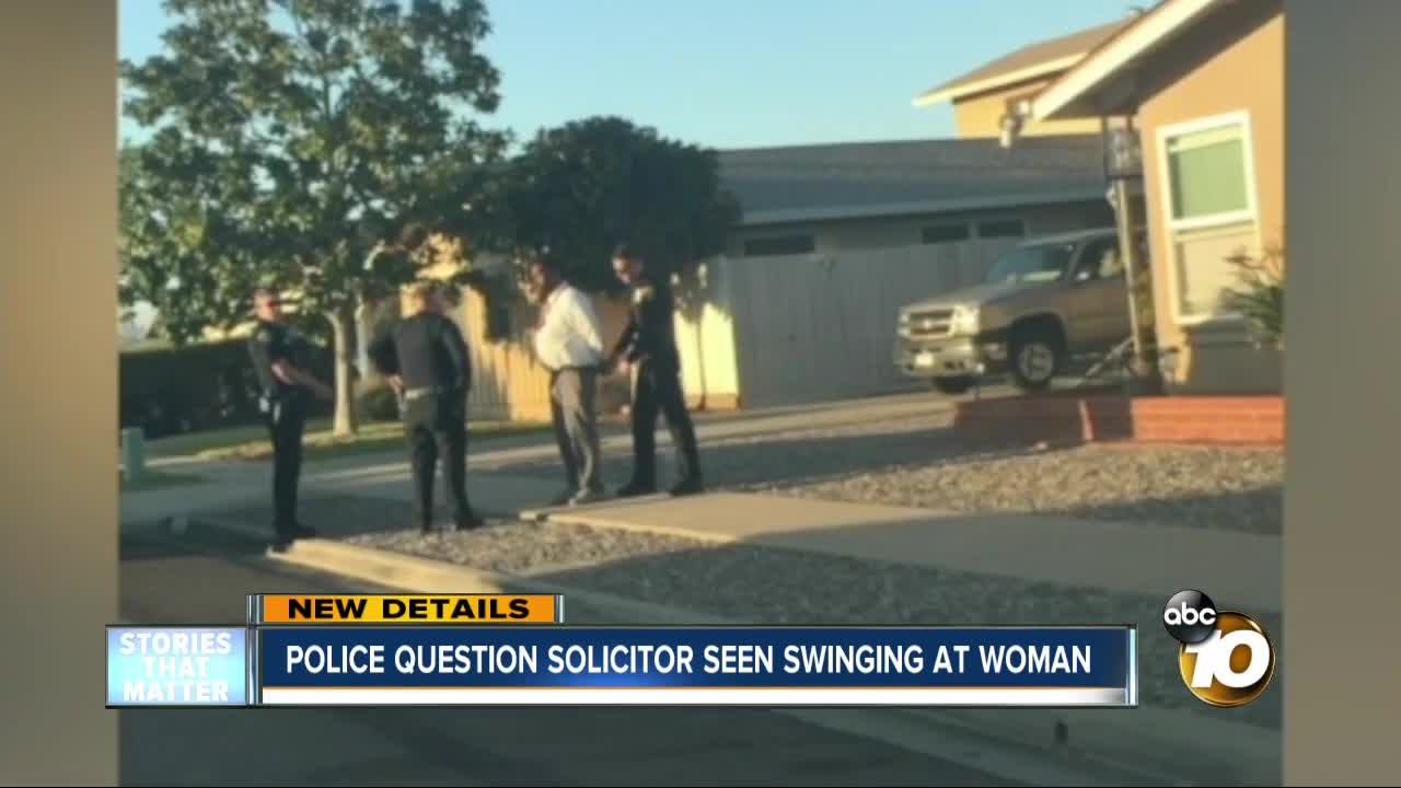 Police question solicitor seen swinging at woman