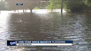 Burlington flood victim still recovering after one year - Video