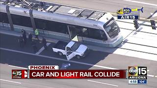 Woman turns in front of light rail in west Phoenix - Video