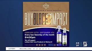 Local business owners holing Buy Black 2 Impact Our Community