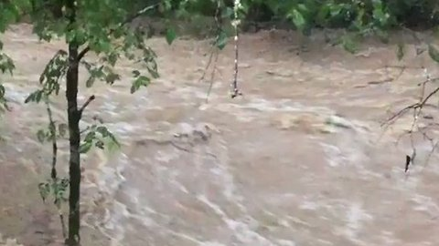 Creek Rages in Alexandria, Tennessee, Amid Flash Flood Warning
