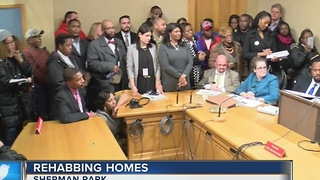 Hundreds fill City Hall hoping for $1 homes - Video