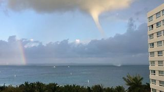 Rainbow Forms Close to a Waterspout Near Cancun - Video