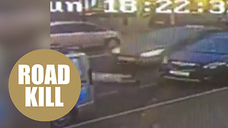 Shocking CCTV shows six-year-old boy being struck as he crossed busy road - Video