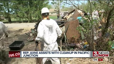 Rep. Cindy Axne helps clean up efforts in Pacific Junction