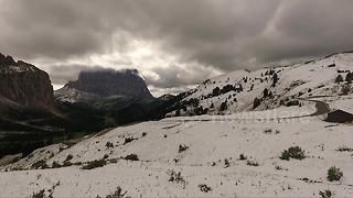 Rare snowfall covers the Italian Alps during summer - Video