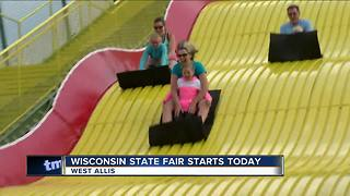 Wisconsinites flock to the giant slide at the State Fair - Video
