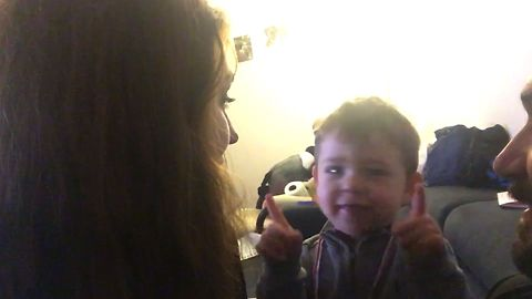 Cute Kid Doesn't Approve With His Parents Kissing