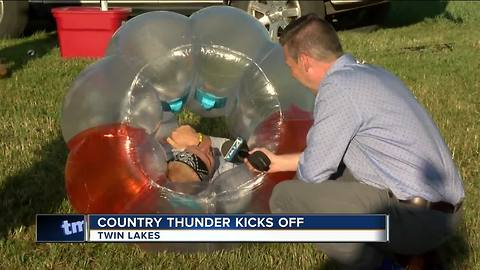 Campers sleep overnight for first day of Country Thunder
