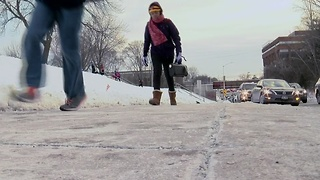 Local students cope with the bitter cold weather - Video