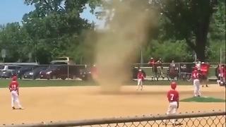 'Tornado timeout': Video shows dust devil whipping up during children's baseball game