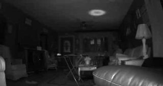 Security camera captures mysterious light in living room