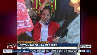Skydiving Santa crashes into tree and pole - Video