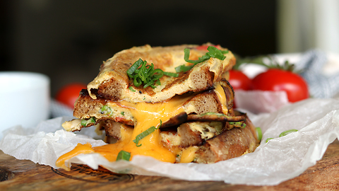 Mouthwatering grilled cheese omelette sandwich