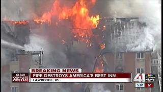 Lawrence fire crews battle motel fire
