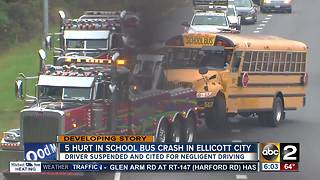 Police: Bus driver at fault after school bus overturns, 5 taken to hospital - Video