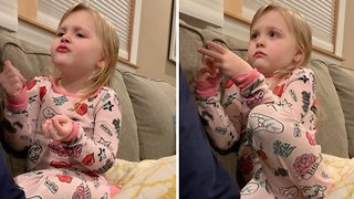 Cheeky toddler ties herself in knots trying to explain how another kid's toy ended up in her bag