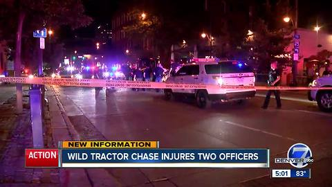 John Deere tractor leads police on a slow chase through downtown Denver