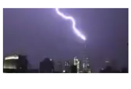 Lightning Lights up NYC Skyline, Strikes Freedom Tower - Video