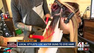 Local stylists use water guns to dye hair - Video