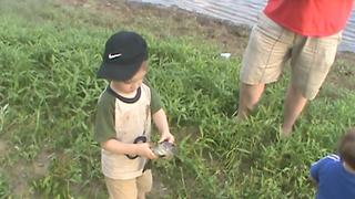 Tot Boy Freaks Out Over A Fish - Video