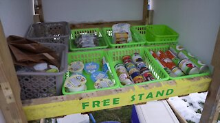 Community leaders set up free food stands around Lansing