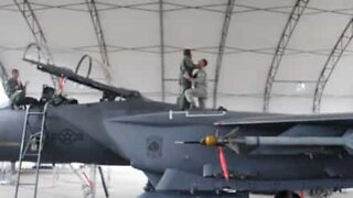 Air force sergeant proposes on fighter jet wing
