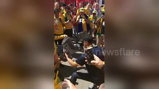 Australian fan performs 'shoey' from moon boot after Australia draw with Denmark - Video