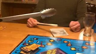 Family respects social distancing while playing board game