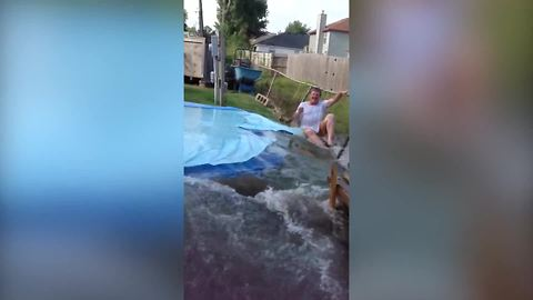 Man Slices Holes Into A Pool And The Water Flow Knocks Him Down