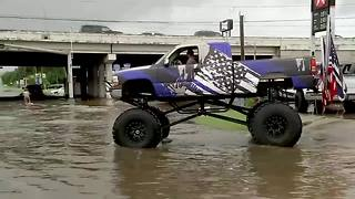 A Houston man used a Monster truck to help him navigate flood waters and rescue stranded drivers. - Video