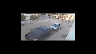 Stupid thief caught while trying to break in a car!!