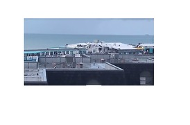 Microburst Blows Roof off Cocoa Beach Pier Building - Video