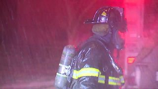Cleveland firefighters battle house fire in frigid temperatures
